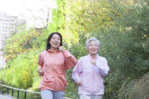 Senior woman and daughter outside walking