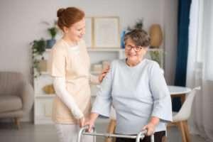 Medical caretaker helping senior woman
