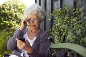 Senior woman looking at mobile phone